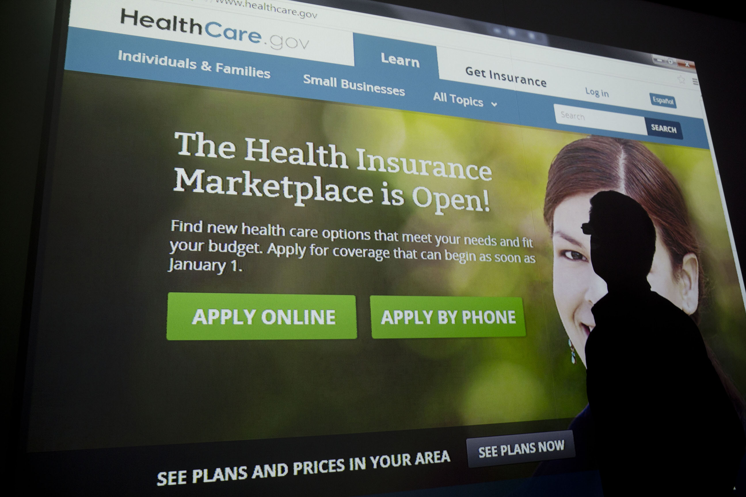 A man's shadow is silhouetted against the Healthcare.gov website in this illustration taken in Washington, D.C., U.S., on Thursday, Oct. 24, 2013.  Photographer: Andrew Harrer/Bloomberg