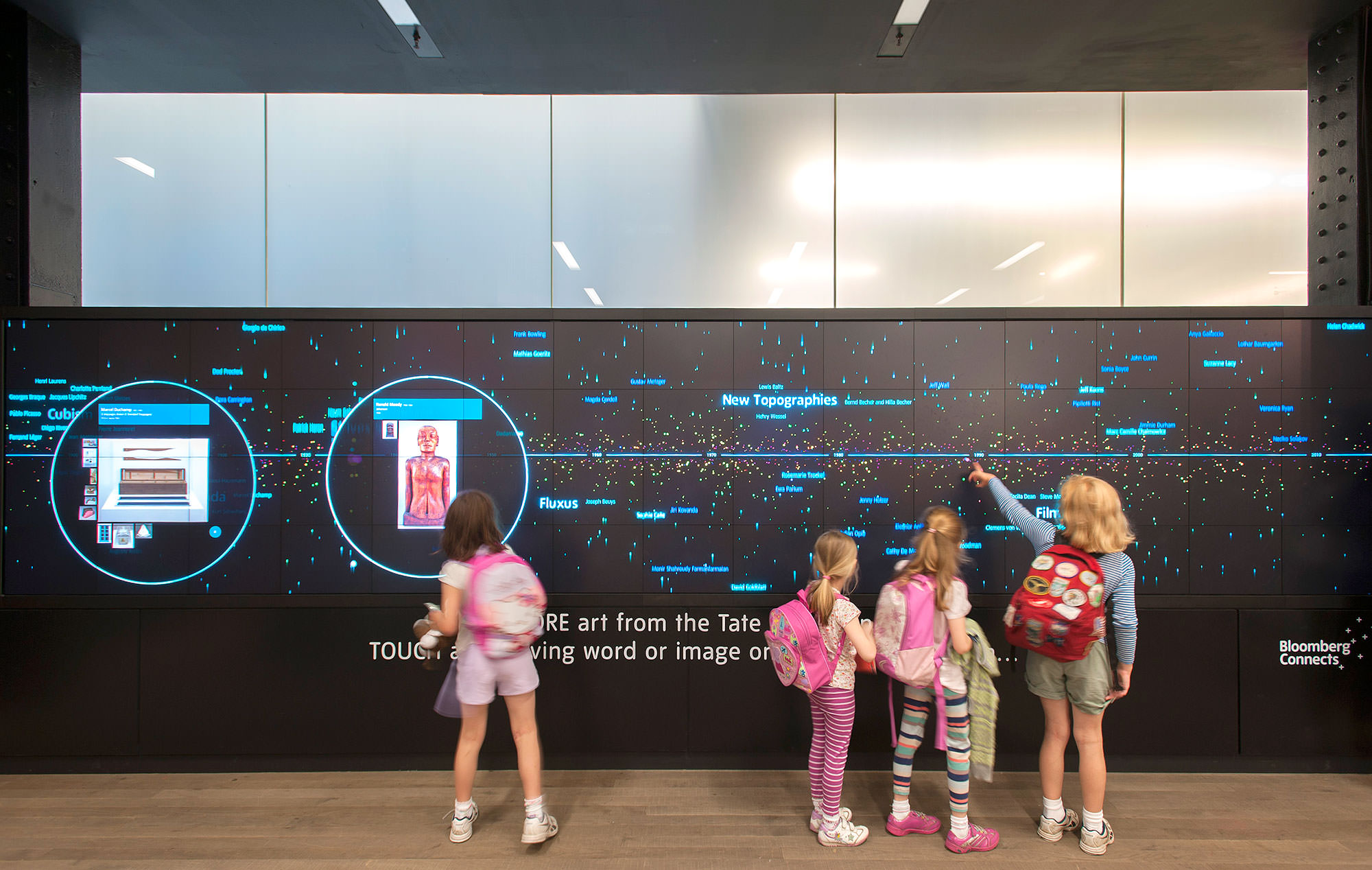 Local kids interact with the Tate's Timeline of Modern Art history, a Bloomberg Connects digital platform, part of Tate Modern's expanded partnership with Bloomberg Philanthropies in 2015