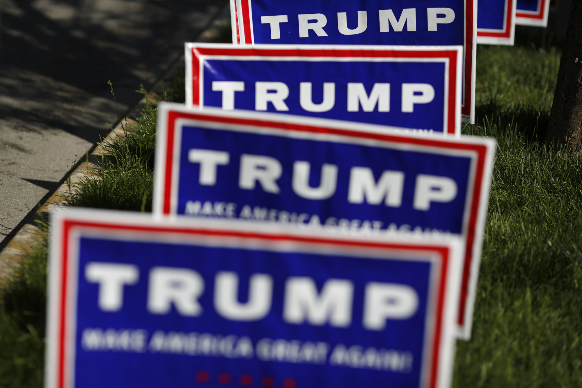 "Signs are displayed outside a campaign event for Donald Trump, president and chief executive of Trump Organization Inc. and 2016 Republican presidential candidate, in Evansville, Indiana, U.S., on Thursday, April 28, 2016. Trump said he's campaigning hard to win Tuesday's presidential primary in Indiana and that if he prevails, his party's nomination contest will be ""over."" Photographer: Luke Sharrett/Bloomberg"