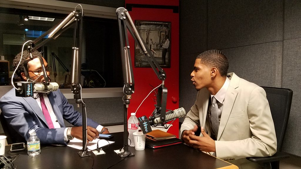 Niiobli Armah IV of Bloomberg Associates speaking to Asa Singleton, an MBK program participant, in 2018.