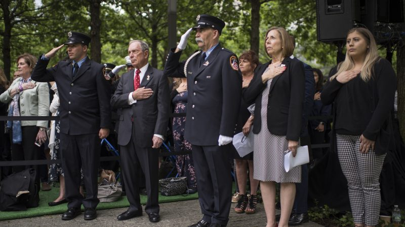 Mike Bloomberg and Alice Greenwald with members of New York City Fire Department at the 9/11 Memorial Glade dedication ceremony in May, 2019.