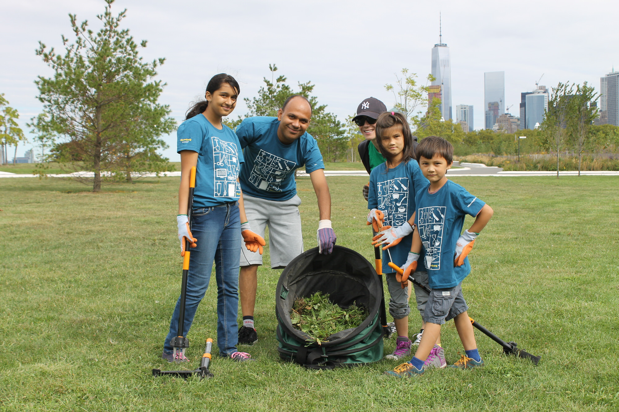 Bloomberg employees and their families help clean up Governors Island Park in New York