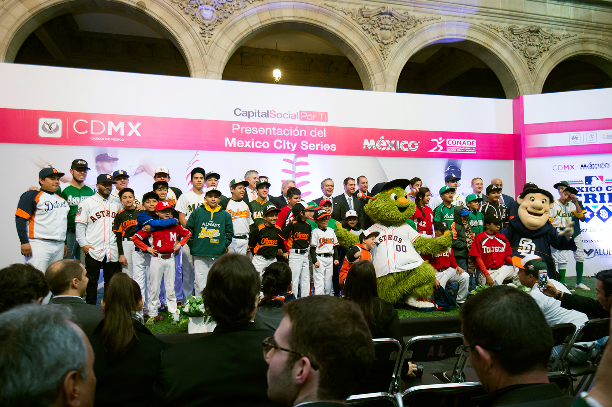 Youth baseball players pose with mascots on stage during the announcement of the Spring Training Mexico City Series between the Houston Astros and the San Diego Padres on Wednesday, January 13, 2016 at City Hall in Mexico City, Mexico. Photo by Gabriel Roux/MLB Photos.