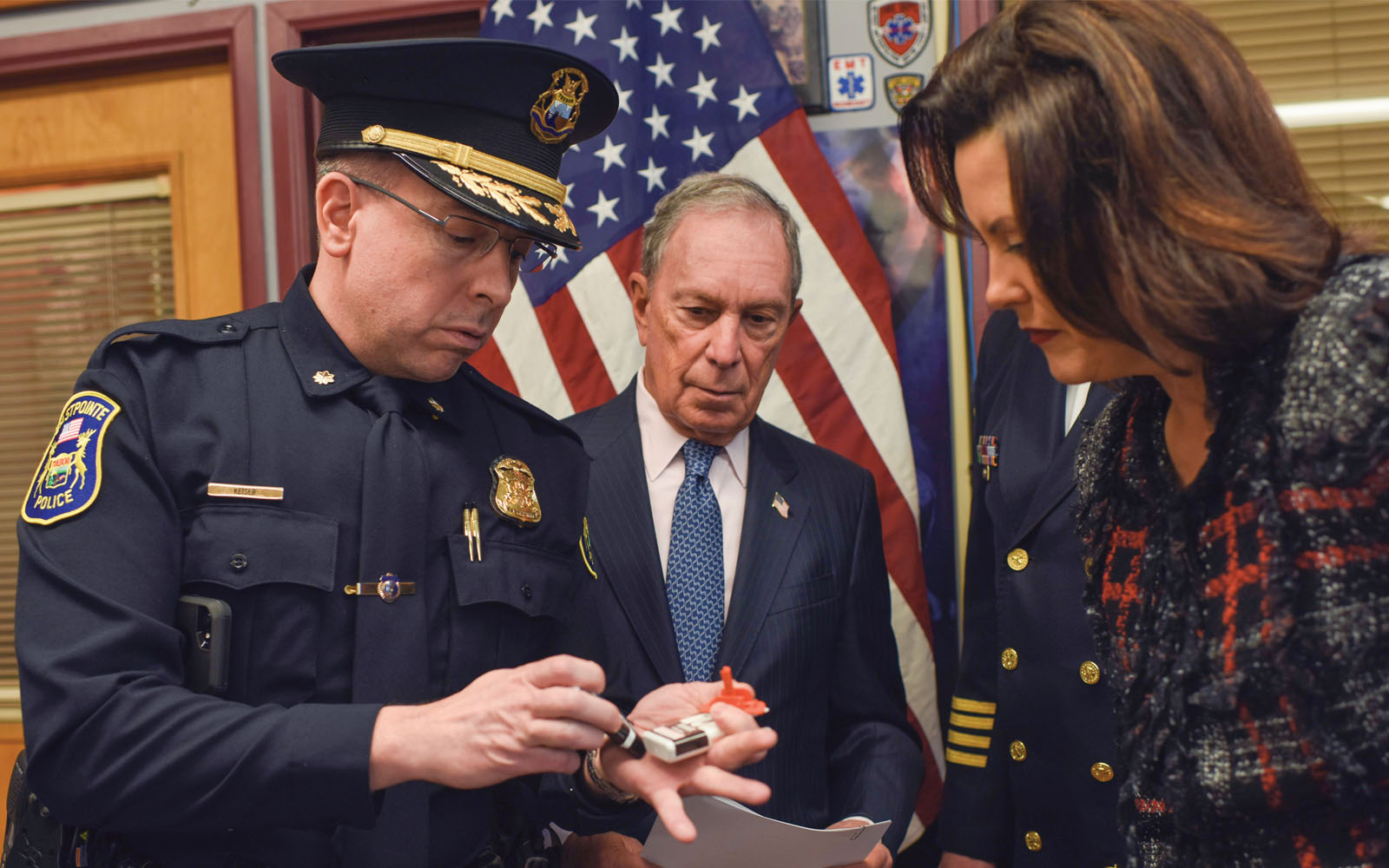 Deputy Police Chief Eric Keiser of Eastpointe, Michigan, demonstrates how to administer the overdose-reversing drug naloxone for Mike Bloomberg and Michigan Governor Gretchen Whitmer.