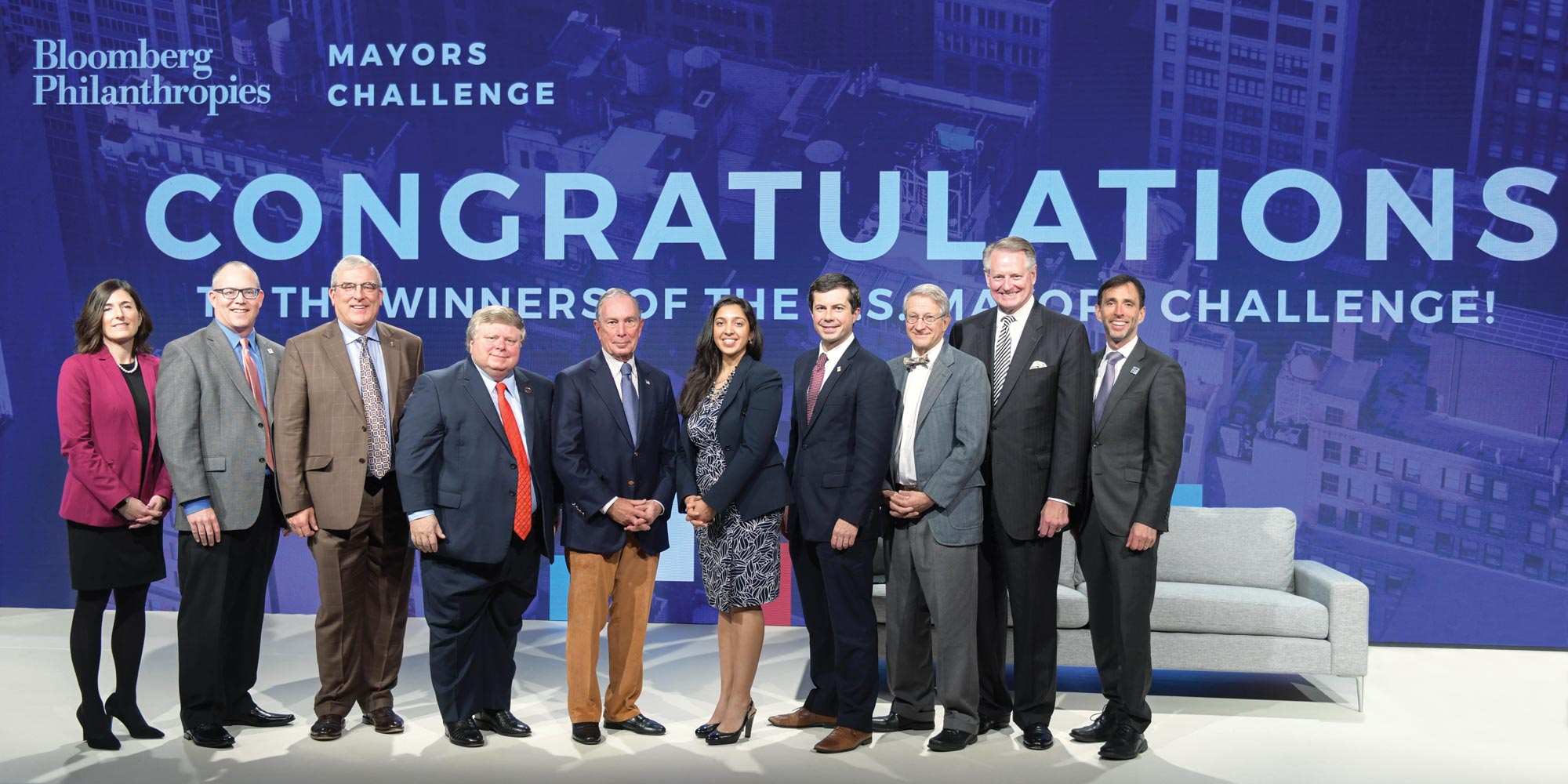 Mayors and representatives of the winning cities in the 2018 Mayors Challenge join Mike Bloomberg onstage at CityLab 2018 in Detroit, Michigan.
