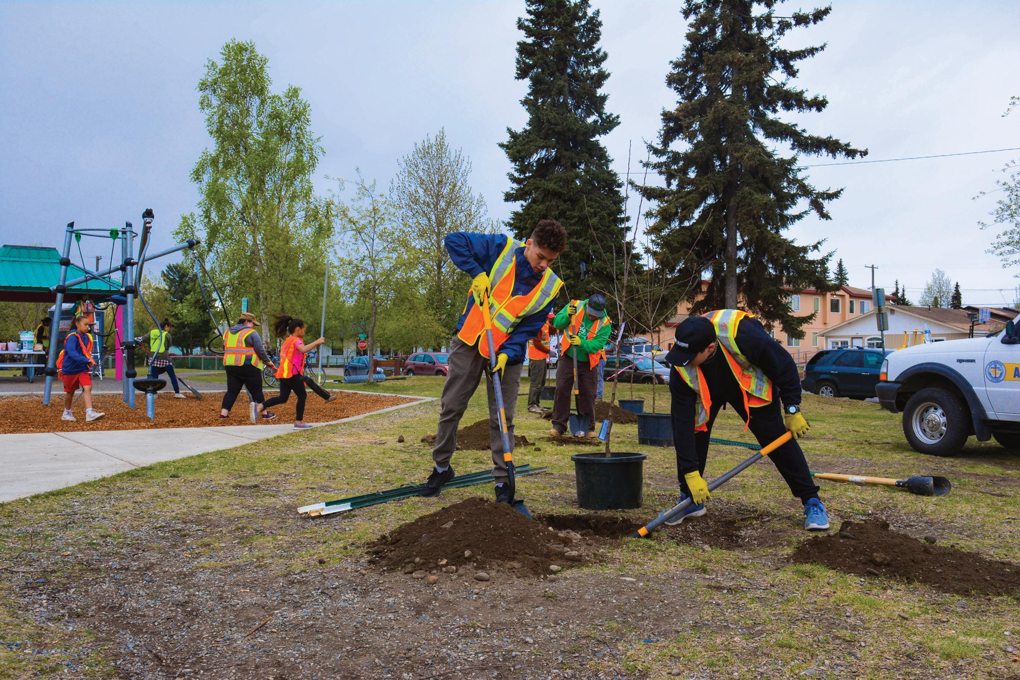 Volunteers in Anchorage, Alaska, plant trees at the Fairview Park Fix-It as part of the Cities of Service Resilience AmeriCorps program.