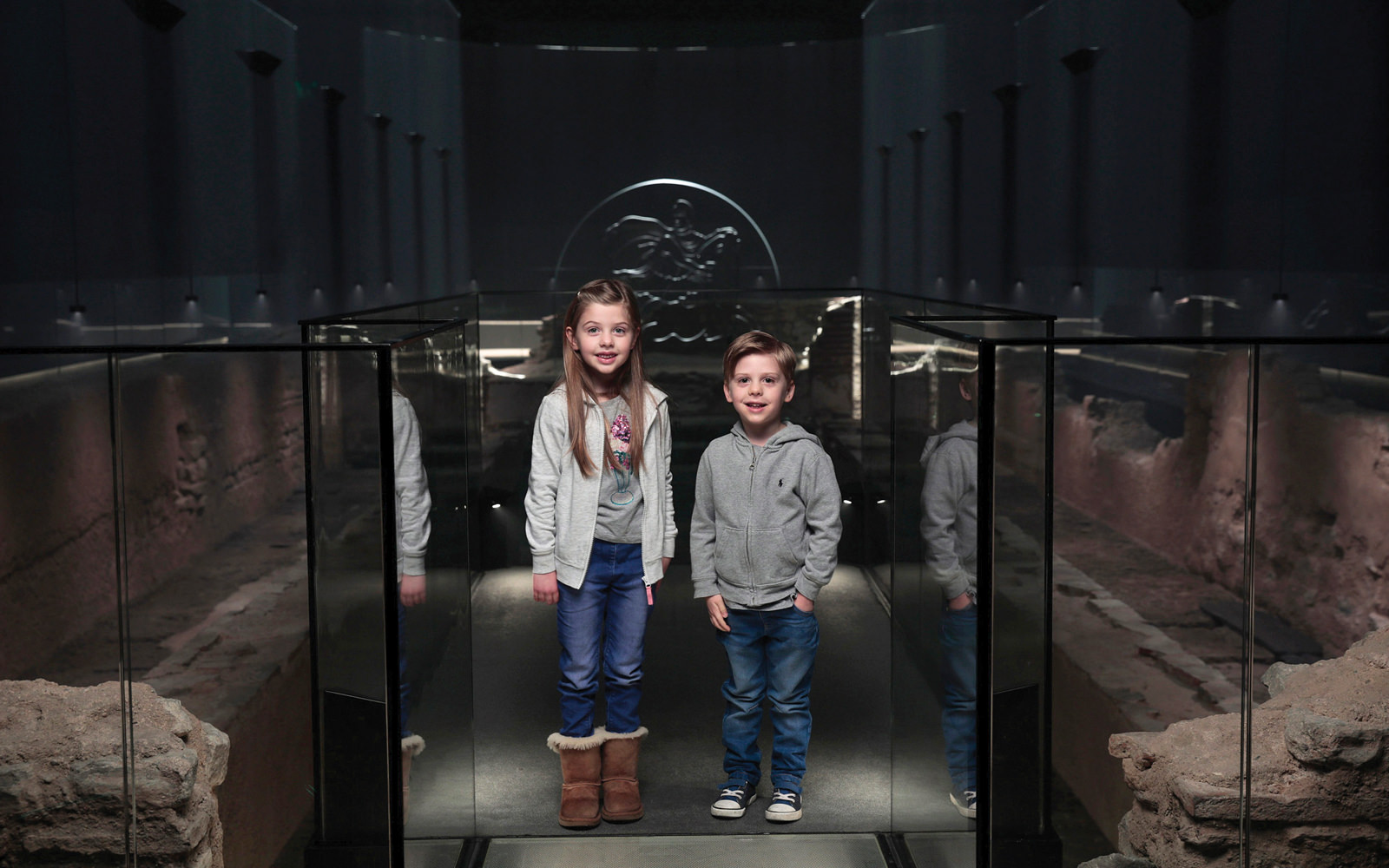 Children exploring the London Mithraeum at Bloomberg L.P.'s European headquarters.