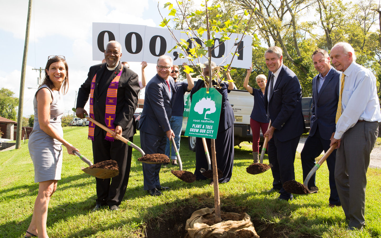 Mayor David Briley of Nashville, Tennessee, (third from left) joins other community leaders in planting the first tree to launch Root Nashville.
