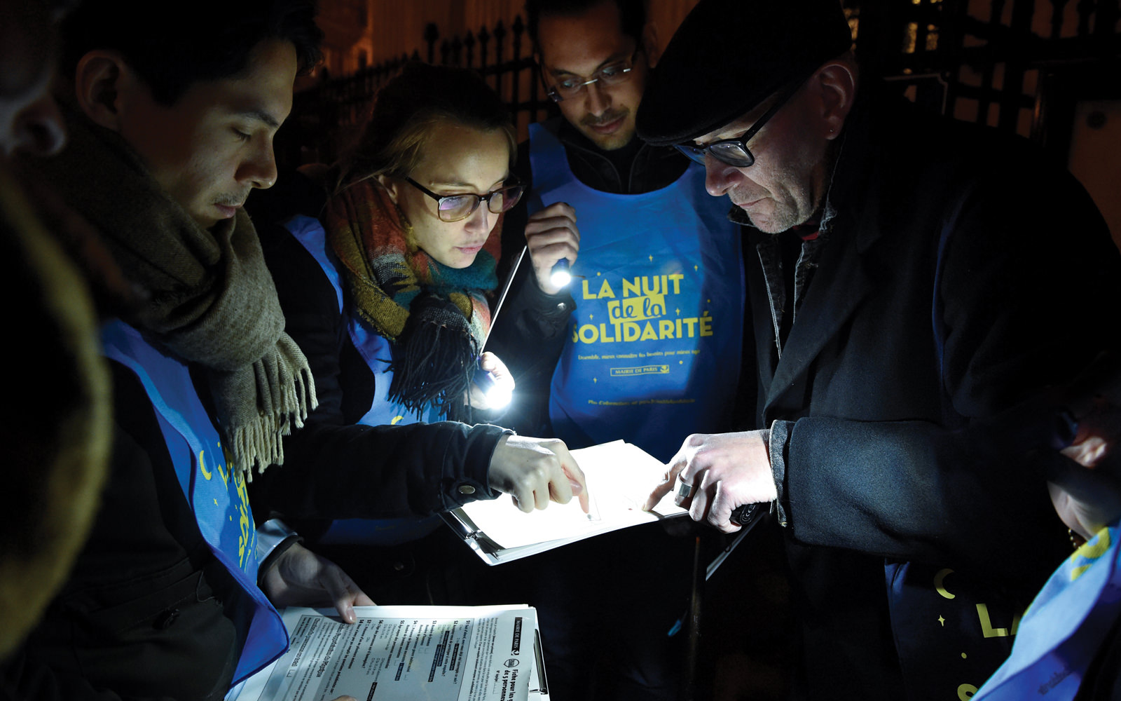 Volunteers conduct Paris's first street homelessness count in 2018.