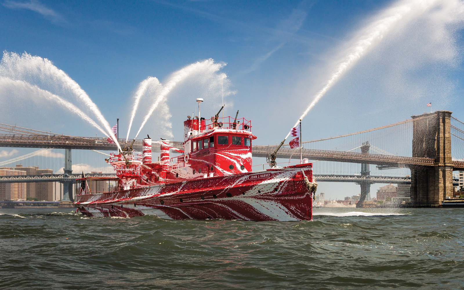A historic fireboat is transformed into a Bloomberg Philanthropies-supported work of art inspired by the vibrant camouflage patterns painted on ships crossing the Atlantic during World War I