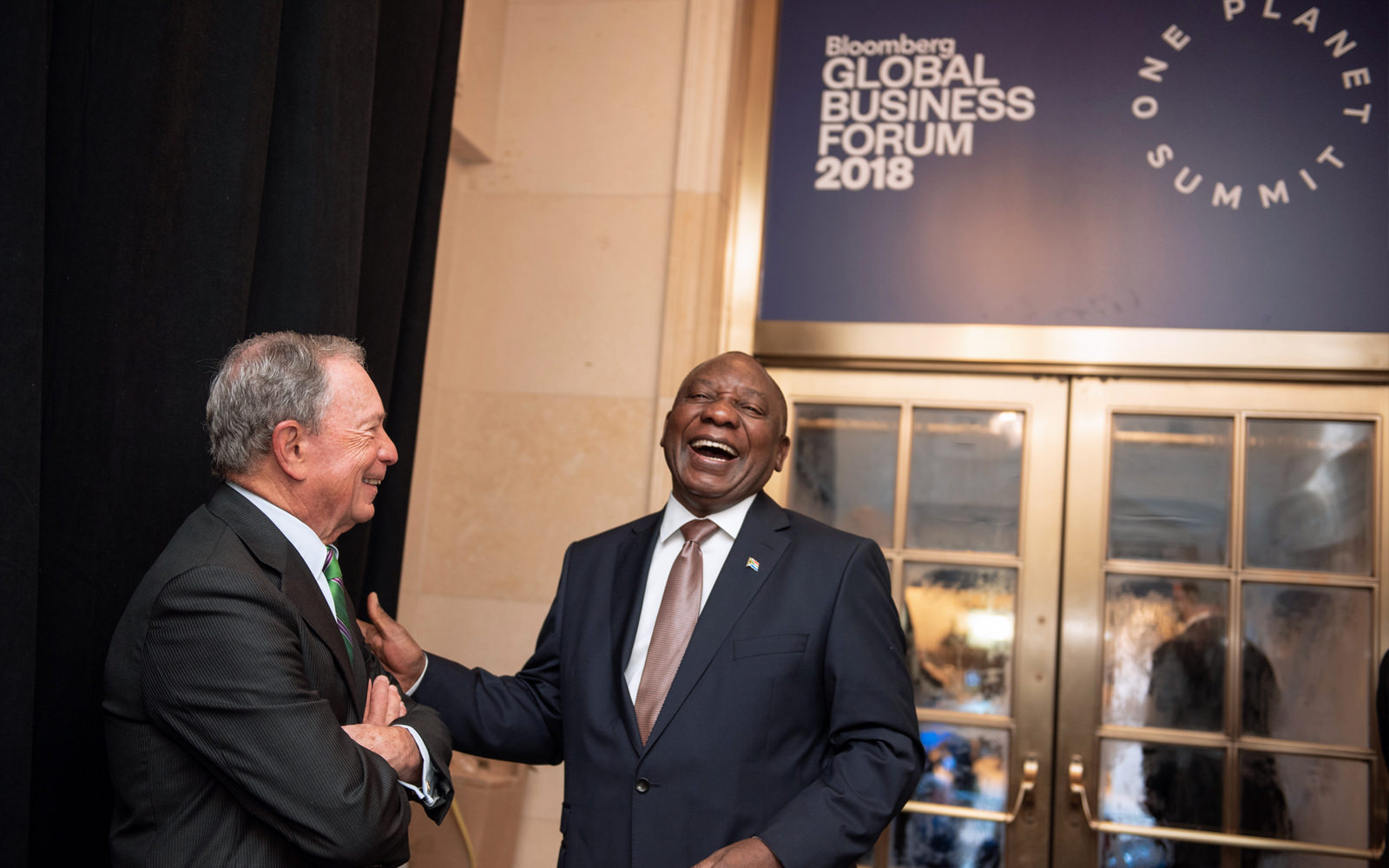 Mike Bloomberg and President Cyril Ramaphosa of South Africa share a laugh at the Bloomberg Global Business Forum in New York City.