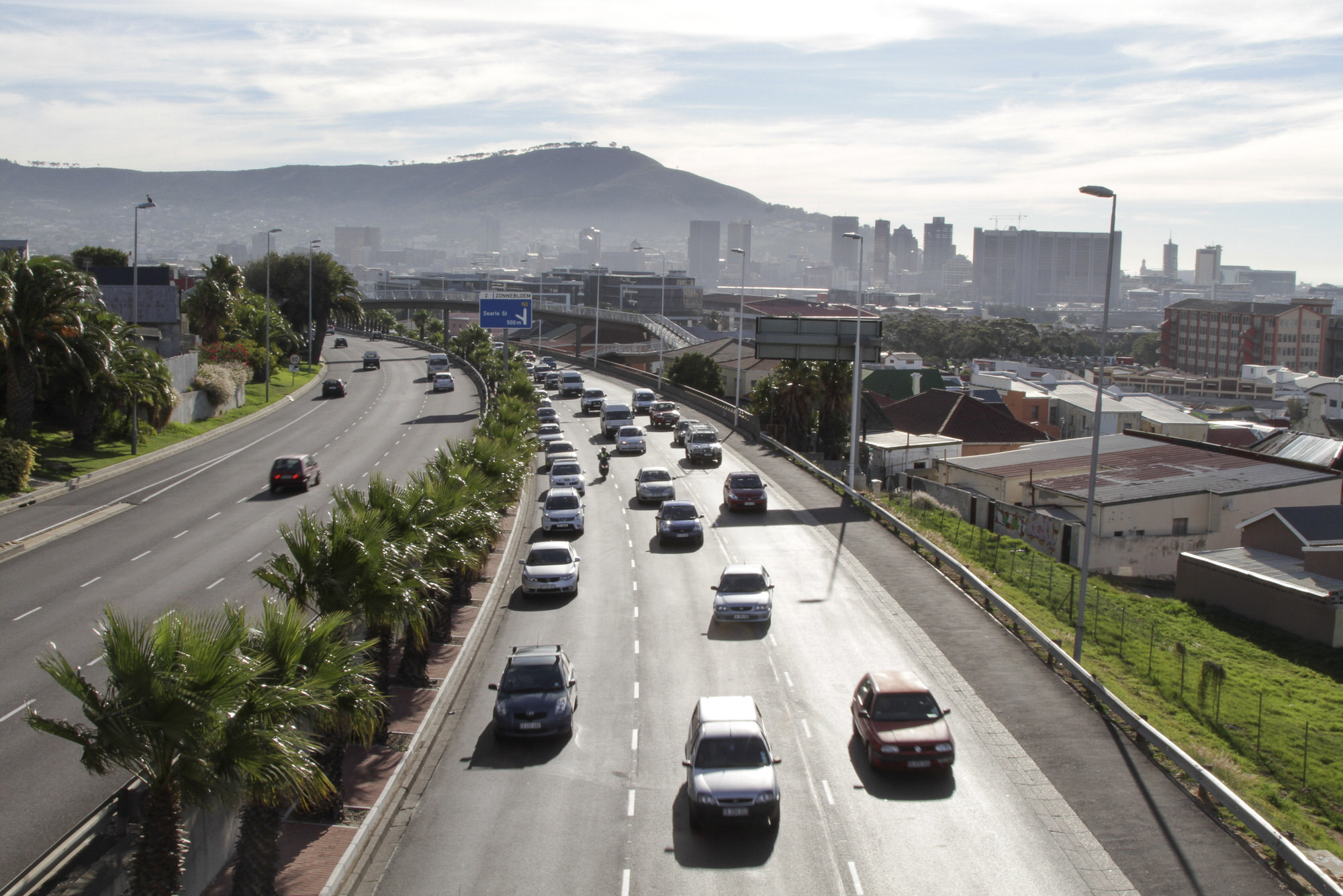 Commuter traffic exits the city center on a highway in Cape Town, South Africa, on Wednesday, April 24, 2013. South Africa's gross domestic product is forecast to expand 2.6 percent this year, compared with 2.5 percent in 2012, according to the country's central bank. Photographer: Nadine Hutton/Bloomberg