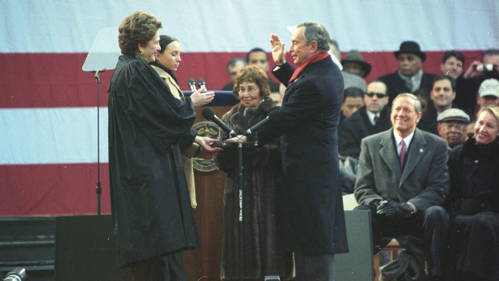 Photo of Mike Bloomberg being sworn into office on a Bible held by his mother.