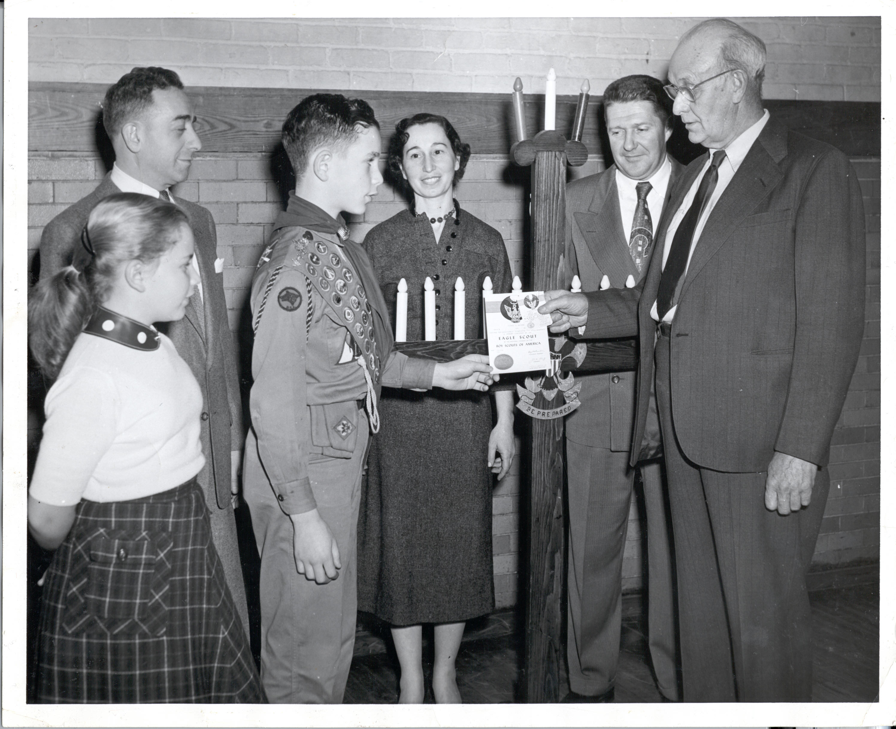 Mike Bloomberg becoming an Eagle Scout with his family.