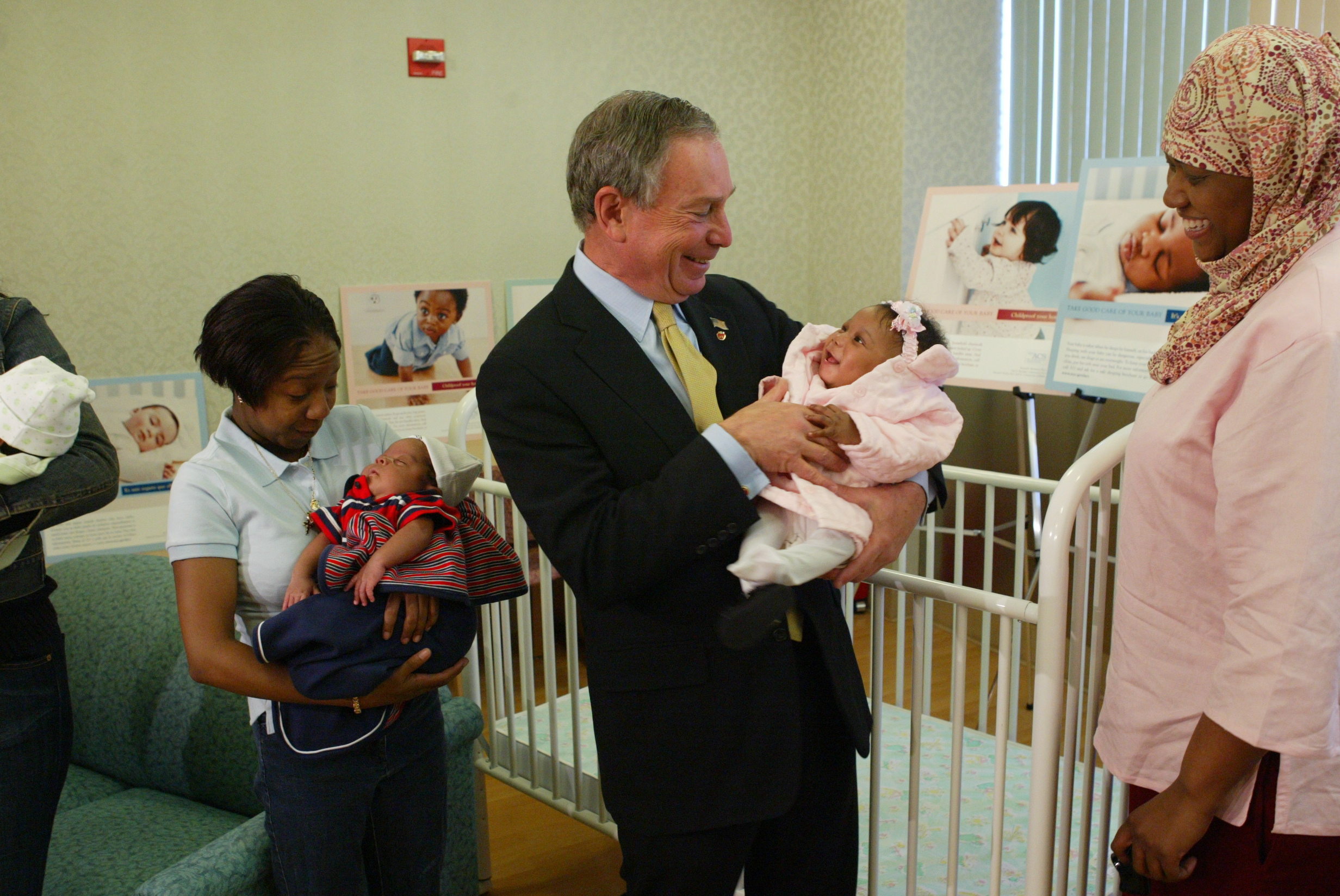 Mike greets infants and their mothers at Harlem Hospital, during the launch of a citywide child safety public service campaign