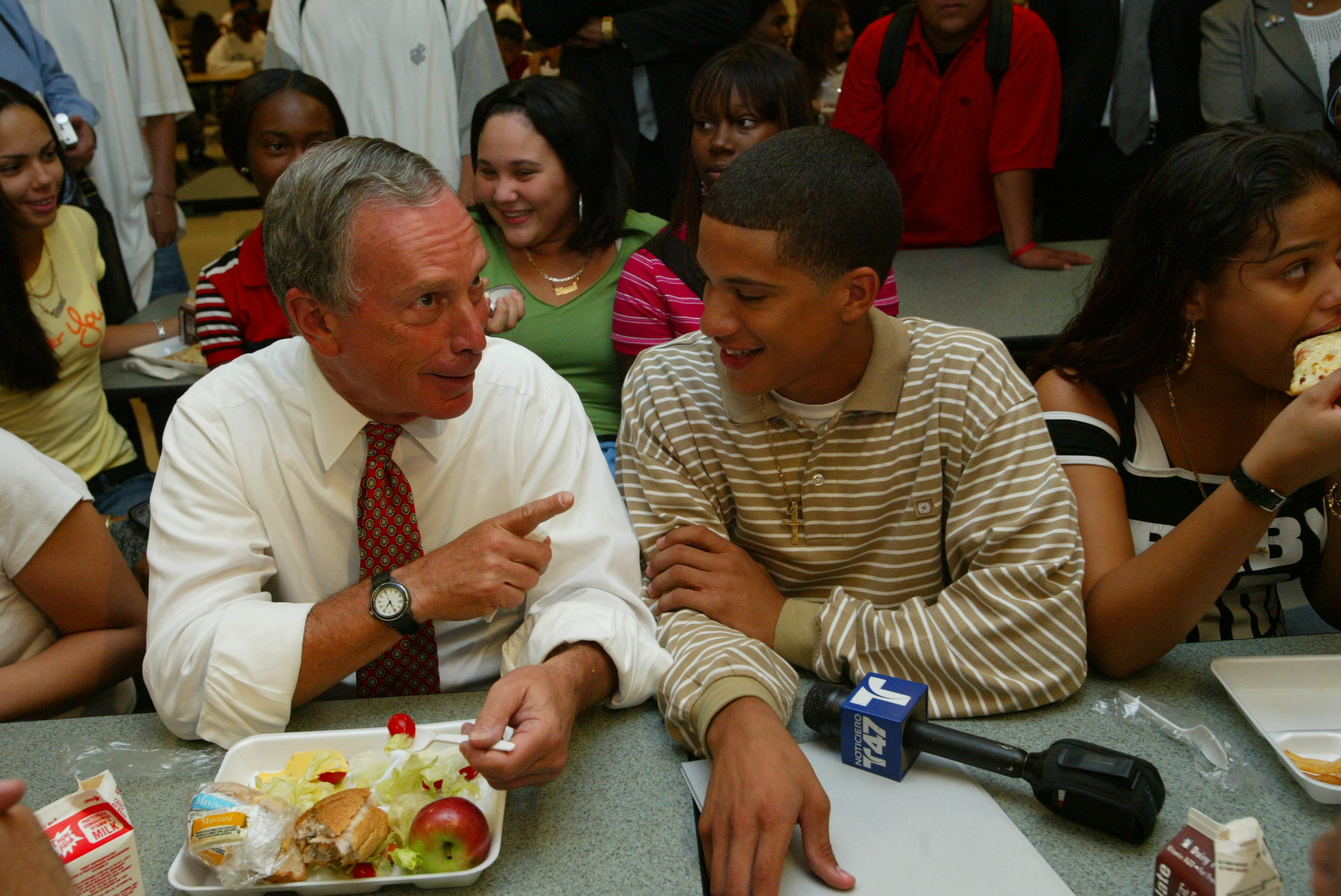 Mike grabs lunch with students during a visit to Queens Vocational & Technical High School
