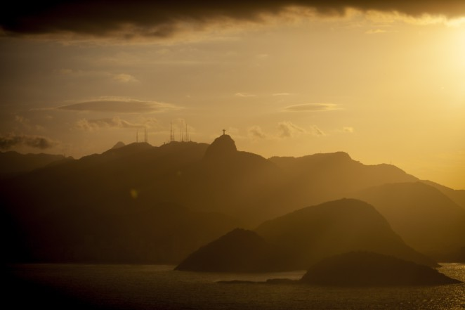 Dusk sets upon mountains along the coast of Rio de Janeiro, Brazil, on Wednesday, May 20, 2015. Even with the real posting the biggest drop among major currencies this year, Brazil's current account gap has hovered near a record as a percentage of gross domestic product. Photographer: Dado Galdieri/Bloomberg
