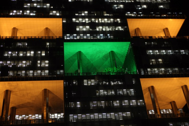 Petrobras headquarters building is lit in Brazil's national colors ahead of an important oil field bid promoted by the state run oil giant in its pre salt fields to take place in Rio de Janeiro, Brazil, Sunday, Oct. 20, 2013. (Photographer: Dado Galdieri/Bloomberg)