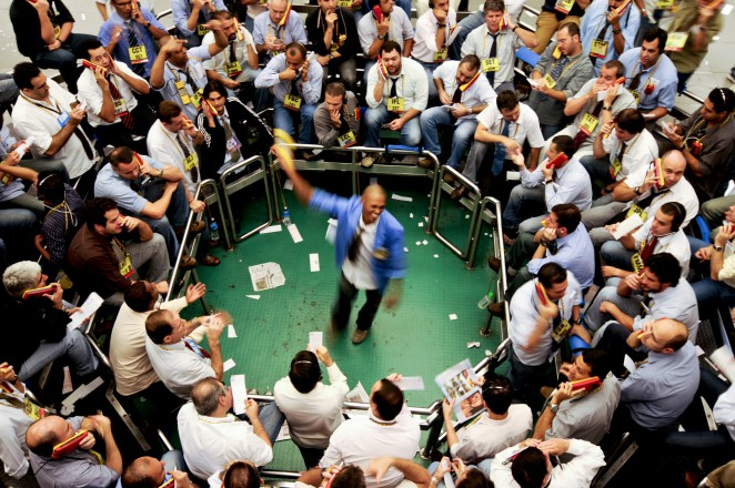 Traders signal orders at the Brazilian Bolsa de Mercadorias e Futuros, or Brazilian Mercantile and Futures Exchange (BM&F), in Sao Paulo, Brazil, on Friday, May 2nd, 2008. Brazil's Bovespa is climbing as Brazil achieved investment grade on April 30th, 2008