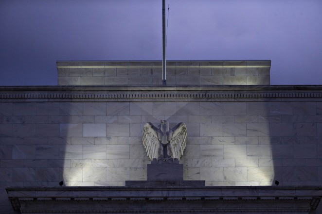 An eagle sculpture stands on the facade of the Marriner S. Eccles Federal Reserve building in Washington, D.C., U.S., on Tuesday, Dec. 15, 2015. Economists and traders expect the policy-setting Federal Open Market Committee to raise interest rates tomorrow for the first time since 2006, marking the beginning of the end for the unprecedented era of easy monetary policy. Photographer: Andrew Harrer/Bloomberg