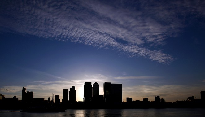 The Canary Wharf financial district is silhouetted against the dusk sky in London, U.K., on Tuesday, April 27, 2010. Barclays Plc plans to increase funding for its private equity business focused on natural resources by 50 percent this year, a company executive said. Photographer: Simon Dawson/Bloomberg