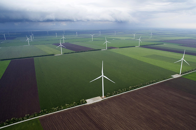 Wind turbines, manufactured by Vestas Wind Systems A/S, operate near farmland in this aerial photo at the Botievo wind farm operated by DTEK Holdings Ltd. in Botievo, Ukraine, on Thursday, May 26, 2016. DTEK is controlled by Ukrainian billionaire Rinat Akhmetov. Photographer: Vincent Mundy/Bloomberg
