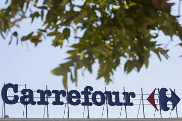 A logo stands on display above a Carrefour SA supermarket, part of the Marinopoulos Group, in Limassol, Cyprus, on Monday, Sept. 9, 2014. The Cypriot economy contracted 0.3% in 2Q from previous quarter, vs 0.6% q/q drop in 1Q, according to seasonally adjusted estimates posted on Cyprus Statistical Service website. Photographer: Andrew Caballero-Reynolds/Bloomberg