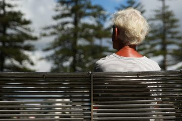A man sits on a bench in Sydney, Australia, on Wednesday, April 1, 2015. The number of people in Australia aged 65 and over is expected to double by 2055. Photographer: Brendon Thorne/Bloomberg