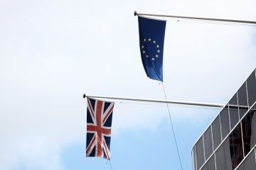 A British Union Flag, also know as a Union Jack, left, and a European Union (EU) flag fly on the side of a building in London, U.K., on Tuesday, June 28, 2016. The pound rose for the first time since the U.K.'s vote to leave the European Union, as a recovery in investor appetite for higher-yielding assets seeped through currency markets. Photographer: Chris Ratcliffe/Bloomberg