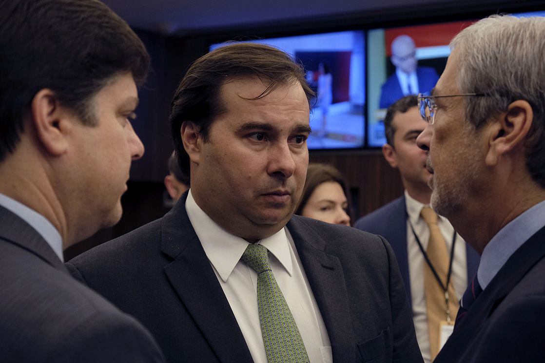 Lower House President Rodrigo Maia speaks with attendees during a press event in Brasilia, Brazil, on Wednesday, March 8, 2017. Brazil policy makers are redoubling reform efforts to end a third year of recession, after signs of wavering support in Congress unnerved investors. Photographer: Gustavo Gomes/Bloomberg