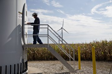 A technician enters a wind turbine on property used by the Alliant Energy Corp. Whispering Willow Wind Farm in Iowa Falls, Iowa, U.S., on Thursday, Sept. 15, 2016. Wind energy, the fastest-growing source of electricity in the U.S., is transforming low-income rural areas in ways not seen since the federal government gave land to homesteaders 150 years ago. Photographer: Daniel Acker/Bloomberg