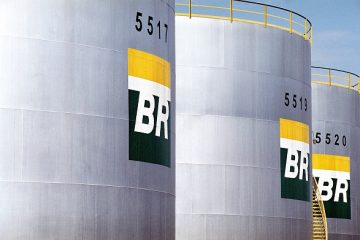 Storage tanks bearing the company's logo are pictured at the Petroleos Brasileiros refinery at Duque de Caxias, Brazil, on Tuesday, September 16, 2003. Petroleo Brasileiro, known as Petrobras, is Brazil's state-owned oil company. Photographer: Pedro Lobo/Bloomberg News