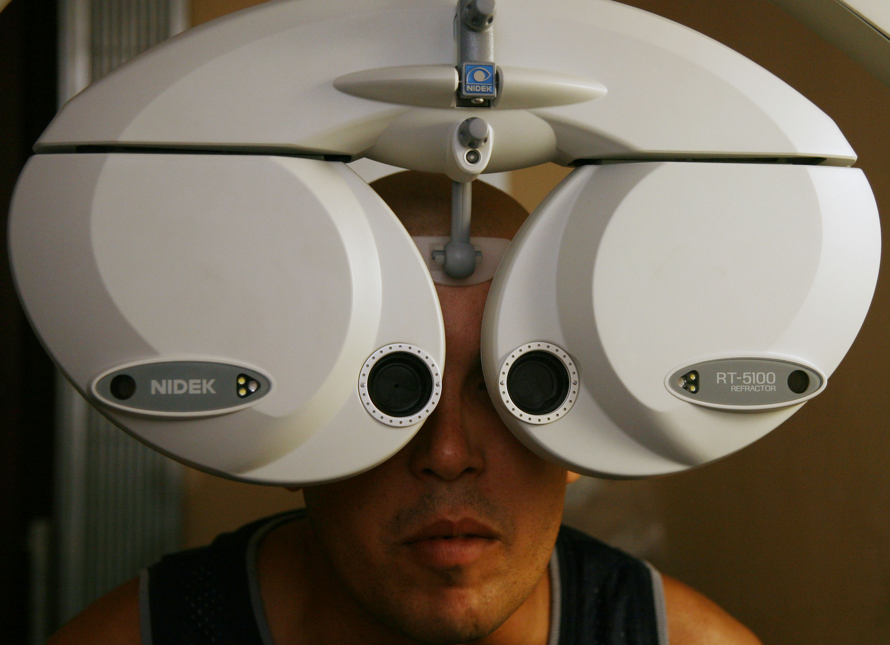 A man is examined at the Pando Ferrer Eyes Hospital, a model hospital in its specialty, in Havana, Cuba, Tuesday, September 12, 2006. Photographer: Diego Giudice/Bloomberg News.