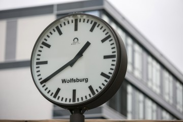 An analogue clock face shows the time in Wolfsburg, Germany, on Tuesday, Oct. 13, 2015. Volkswagen AG Chief Executive Officer Matthias Mueller faced employees at the German company's headquarters last week as pressure mounts to slash spending in the wake of the diesel-emissions scandal. Photographer: Krisztian Bocsi/Bloomberg