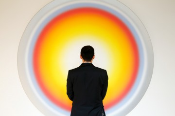 """An employee stands in front of Ugo Rondinone's artwork """"Nr.293 Siebterjanuarzweitausendunddrei"""" during a preview of A Visual Odyssey: Selections from LAC (Lambert Art Collection) at Ely House in this arranged photograph in London, U.K., on Monday, Oct. 12, 2015. The collection, staged for exhibition by French interior designer Jacques Grange, will be sold at auction by Christie's International Plc in association with de Pury Pictet Turrettini & Cie SA, in London on Oct. 14. Photographer: Luke MacGregor/Bloomberg"""