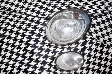 A vinyl wrapped pattern sits on a Fiat 500 during the launch of Garage Italia Customs new headquarters in Milan, Italy, on Wednesday Oct. 7, 2015. Garage Italia Customs, who customize automobiles, moved into the former Agip petrol station in Piazzale Accursio designed by architect Mario Bacciocchi in 1952. Photographer: Marc Hill/Bloomberg
